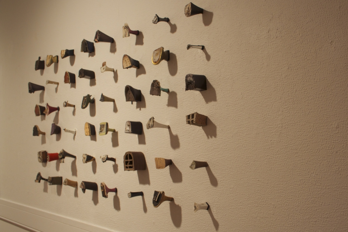 Untitled, by Pitt senior Julia Betts, mixed media wall art made of high heels, 2013