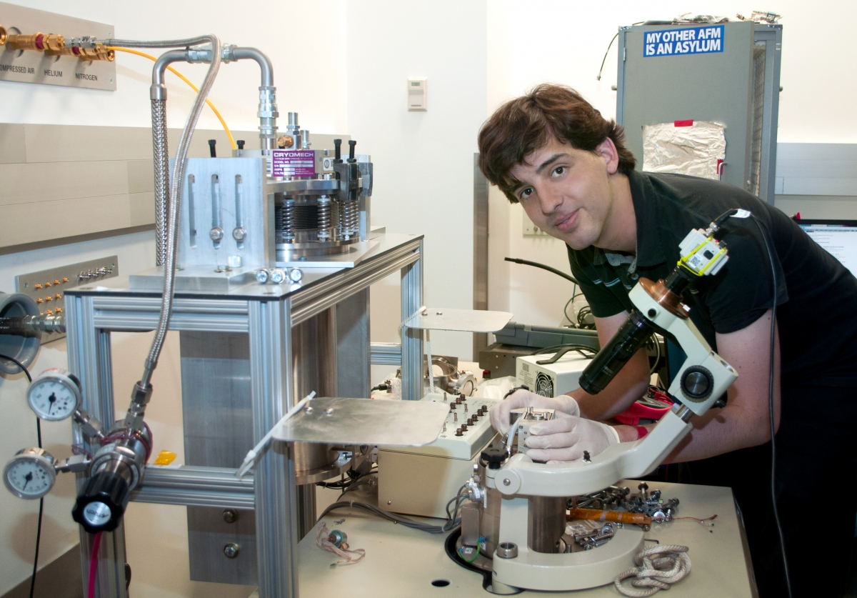 Alexandre Gauthier handles an atomic force microscope within the laboratory of Pitt Professor Jeremy Levy. Gauthier played a major role in the redesign and assembly of this low temperature scanning probe microscope, which is used to study nanoscale systems at extreme temperature lows; such innovations by Gauthier have greatly enhanced the lab's productivity.