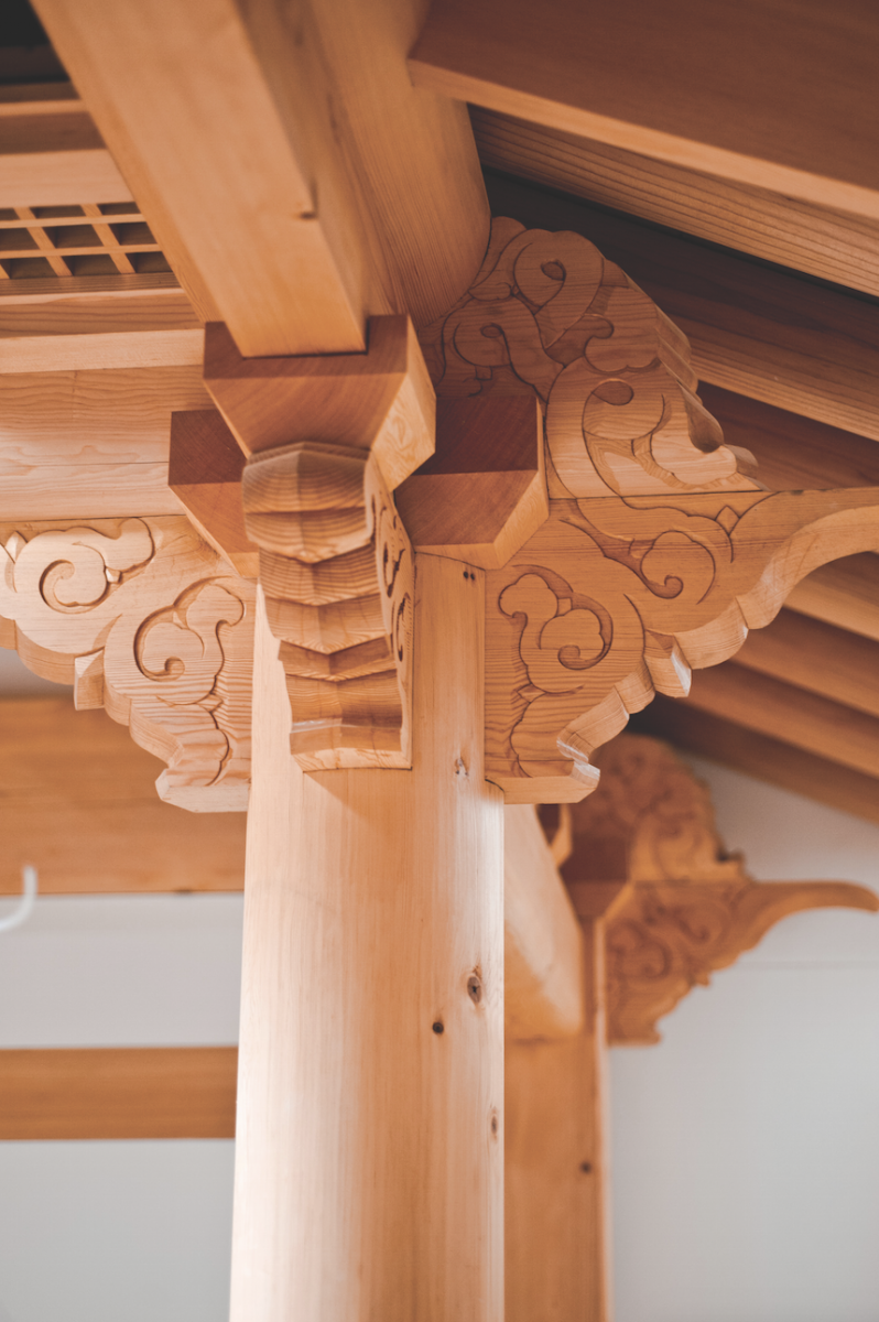 Finely carved woodwork crafted by artisans who specialize in traditional Korean architecture.