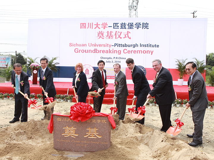 At the groundbreaking ceremony from left are Shijing Yan, vice president of international affairs at Sichuan University; Guangxian Li, executive vice president at Sichuan University; Patricia E. Beeson, provost and senior vice chancellor at Pitt; Heping Xie, president of Sichuan University; Lawrence Feick, director of Pitt's University Center for International Studies; Gregory Marcus, former consular chief at the U.S. Consulate General in Chengdu; Gerald D. Holder, the U.S. Steel Dean of Pitt's Swanson School of Engineering; and Minking Chyu, the Leighton and Mary Orr Chair Professor in Pitt's Swanson School of Engineering.