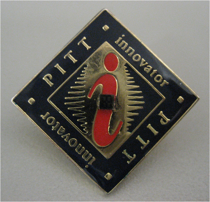 The pH-sensing chip sits in the middle of this Pitt Innovator lapel pin.